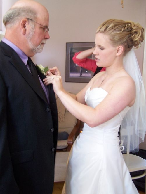 Pinning the Boutonniere on Daddy